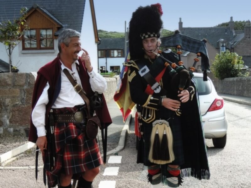 Highland piper and man in kilt