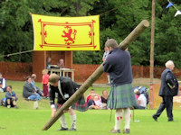 yellow Scotlanf flag and man with caber